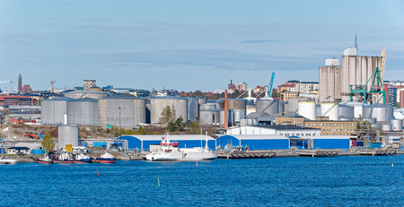 Warehouses, factories and silos at Stockholm industrial sea port district. Sweden. Stock Photo