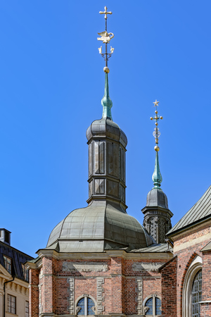 Golden plated decorative details on top of one of main Stokholm landmarks Riddarholm Church (Riddarholm Kyrka) on Riddarholmen island also known as Knights Islet.