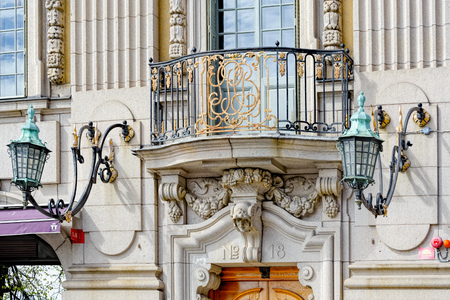 Sveriges Privata Centralbank (Swedens Private Central Bank) gold-plated monogram in the forged balcony rack above the entrance of the massive baroque palace.