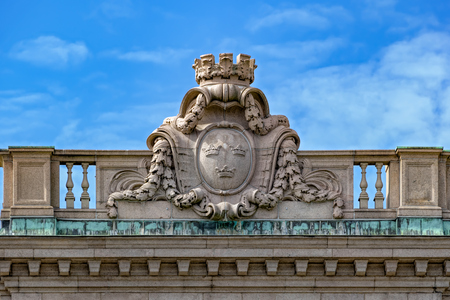 Bas-relief stone ornament of swedish coat of arms on balustrade of Swedish parliament building. Stock Photo