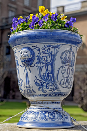 Flower pot outside the Royal castle in Stockholm with the insignia of the King Carl Gustaf XVI. Editorial