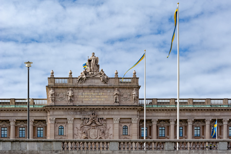 The statue on top of the balustrade of Swedish parliament building depicts Moder Svea, Mother Sweden, an allegorical representation of Sweden, and Royal Coat of Arms.