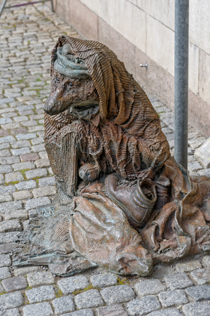 passerby: The sculpture by Laura Ford, named Rag and bone with a blanket, depicts the homeless fox sitting on the pavement.