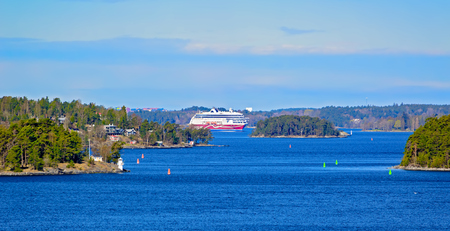 famous industries: Cargo-passenger ferry by Viking line sails through the Stockholm Archipelago in Sweden. Stock Photo