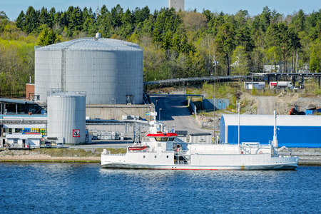 warehouse: LNG tanker berth on oil product tank depot in Stockholm industrial sea port. Sweden. Stock Photo