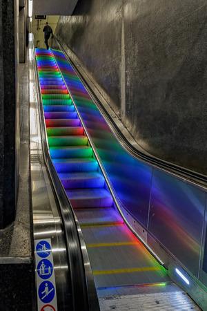 Colourful illuminated escalator steps in metro station, Stockholm, Sweden Redakční