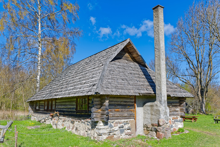 kitchen island: Rustic stone summer kitchen and farm house with weathered old wooden shingles on Hiiumaa island, Estonia
