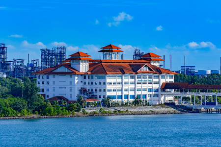 frequented: PORT KLANG, MALAYSIA - April 02, 2017: Building of Boustead Cruise Centre (BCC) is a dedicated cruise terminal in Port Klang, frequently used by international cruise lines also frequented by visiting foreign naval vessels. Editorial