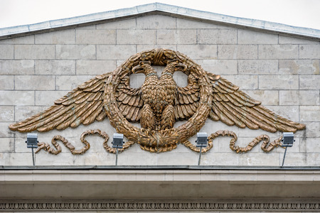 ST. PETERSBURG, RUSSIA - May 18, 2017: Newly restored Russian two-headed eagle sitting in a wreath (pottery, bronze) on facade of the building of the department store DLT - House of Leningrad Trade.
