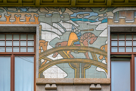 """ST. PETERSBURG, RUSSIA - May 18, 2017: The headquarters of the insurance company Russia in St. Petersburg, with the majolica frieze """"Northern Life"""" decorating the facade. Restored in 2009."""
