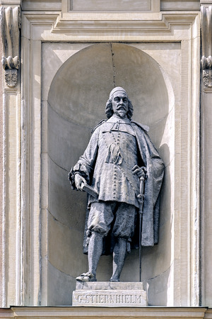 STOCKHOLM, SWEDEN - May 07, 2017: Bronze statue of Georg Stiernhielm, famous Swedish linguist and mathematician, by Johan Axel Wetterlund (1900) on southern facade of Royal Palace in Gamla Stan.