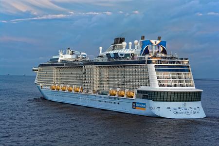 SHANGHAI, CHINA - May 12, 2017: Quantum-Class giant cruise passenger ship Quantum of the Seas by Royal Caribbean International (RCI) sails at sunset twilight near Shanghai.