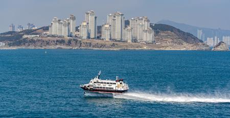 BUSAN, SOUTH KOREA - Feb 19, 2017: Passenger-carrying waterjet-propelled hydrofoil boat JR Beetle2 Jetfoil (Boeing 929-117 by Kawasaki) in exciting trip from Fukuoka (Japan) to Busan (South Korea).