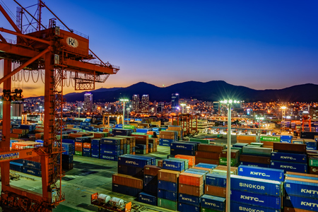 docked: BUSAN, SOUTH KOREA - Jan 21, 2017: Night wide angle panorama of cargo vessel in the port of Busan, South Korea, the fifth largest container terminal harbor in the world.