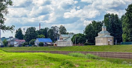 Ancient building along Tikhvinka River embankment in Tikhvin, Russia