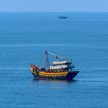 Brightly painted and brilliantly trimmed out with contrasting colors vietnamese modern style Motor Fishing Vessel in the Vung Tau bay.