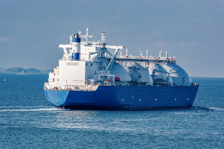 Liquefied natural gas (LNG) tanker is passing by Strait of Singapore. Banco de Imagens