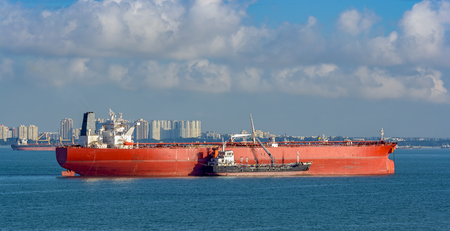 Refuelling or bunkering in marine terms is carried out using a small tanker to pump the bunker fuel into the bigger ship.