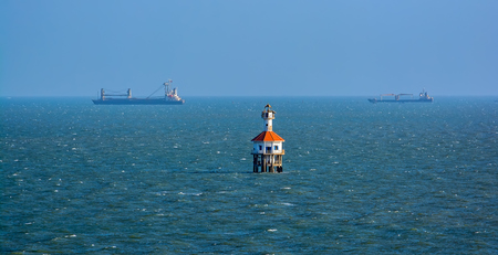 navigational light: Lighthouse Can Gio in the mouth of the Mekong Delta leading to Ho Chi Minh City from South China Sea, Vietnam.