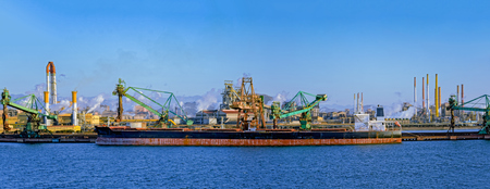 Bulk carrier ships sit berthed near a Posco steel mill at the Port of Gwangyang, Jeonnam, Korea. Stock Photo