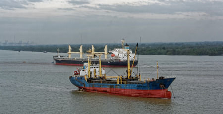 A variety of cargo vessels are shipping on the river Saigon (Song Sai Gon). Vietnam, Southeast Asia