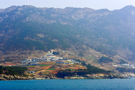 East-China Sea rocky coastline of South Korea with picturesque houses at sunny morning