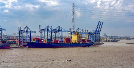 Cargo ships docked at the Saigon Port on the Saigon River (Song Sai Gon), central Ho Chi Minh, Vietnam, Southeast Asia