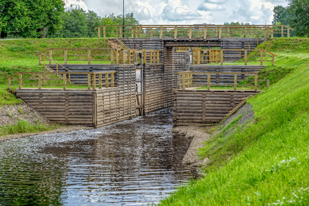 Newly restored elements of historic Tikhvin water system - wooden sluice. Tikhvin, Russia