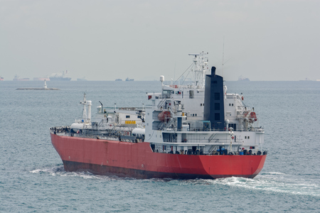 Liquefied Petroleum Gas (LPG) tanker is passing by Strait of Singapore. Stock Photo