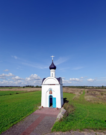 Chapel in honor of the Reigning Mother of God under blue sky. Izborsk, Pskov region, Russia.