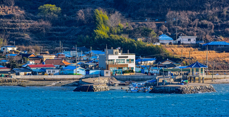 dwelling: East-China Sea rocky coastline of South Korea with picturesque houses at sunny morning