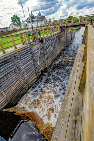 leningrad: Newly restored elements of historic Tikhvin water system - wooden sluice. Tikhvin, Russia