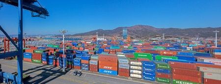 GWANGYANG, SOUTH KOREA - Feb 18, 2017: Panorama of shipping containers stacked at the Gwangyang Container Terminal. Publikacyjne