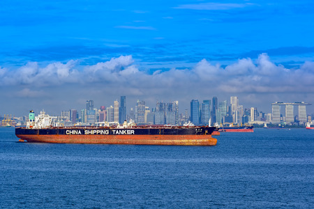 SINGAPORE, MALAYSIA - Jan 06, 2017: Crude oil tanker XIN NING YANG (IMO: 9295024, China) by China Shipping Tanker anchored in ballast in Singapore strait with famous Marina Bay on background. Editorial