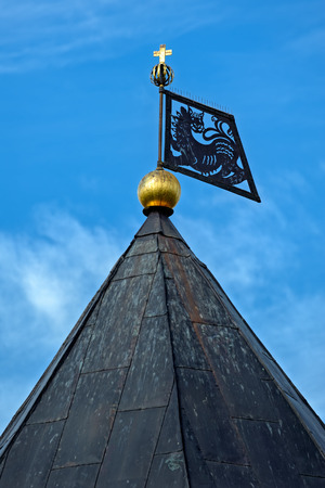 PECHORY, RUSSIA - Sep 17, 2017. Close-up detail view of weather vane on roof of Izborsk tower of Holy Dormition Pskov-Caves Monastery fortress.