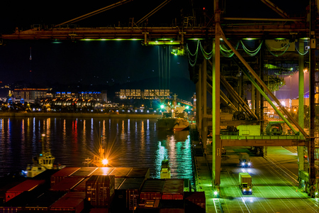 SINGAPORE - Mar 31, 2017: Night view of cargo operations in Singapore container terminal, run by PSA, one of the busiest shipping terminals in the world. Keppel Harbour, Singapore.