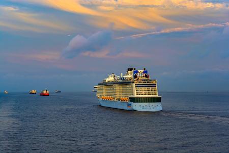 SHANGHAI, CHINA - May 12, 2017: Quantum-Class giant cruise passenger ship 'Quantum of the Seas' by Royal Caribbean International (RCI) sails at sunset twilight near Shanghai. Editöryel
