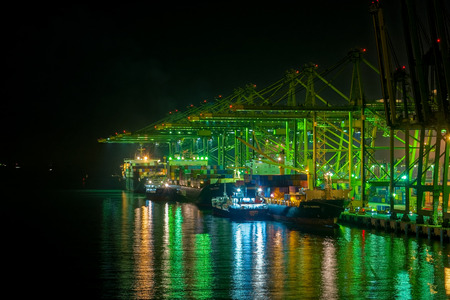 SINGAPORE, SINGAPORE - Sep 15, 2017: Night view of cargo operations in Singapore container terminal, run by PSA, one of the busiest shipping terminals in the world. Keppel Harbour, Singapore.