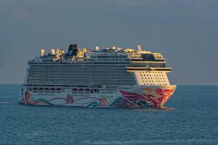 "SHANGHAI, CHINA - Nov 01, 2017: The world's fourth-biggest German-built luxury cruise liner ""Norwegian Joy"" by NCL styled exclusively for Chinese travellers sails at sunset near Shanghai."