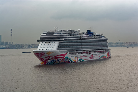"SHANGHAI, CHINA - Nov 06, 2017: The world's fourth-biggest German-built luxury cruise liner ""Norwegian Joy"" by NCL styled exclusively for Chinese travellers is underway at Yangtze River."