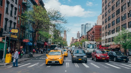 New York, USA / Circa 2016 / Cars at intersection in Hells Kitchen 報道画像