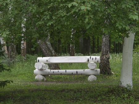 similar: Bench made of wooden logs similar to birch Stock Photo