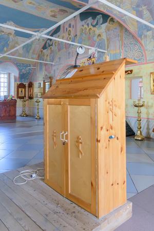 lectern: BOLHOV OF OREL REGION, RUSSIA - AUGUST 15, 2015: Wooden lectern close-up in Trinity Church Editorial