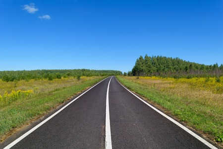 markings: Country asphalt highway with three line of solid white road markings Stock Photo