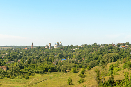 is cloudless: BOLHOV OF OREL REGION, RUSSIA - AUGUST 15, 2015: Panorama of Bolhov from high point with Temple of the Holy Trinity in the center of the frame. Sunny clear summer day. Cloudless blue sky