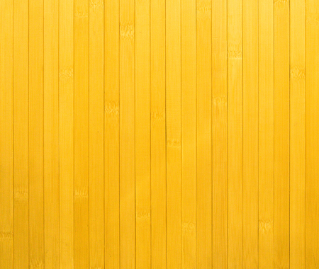 Fragment of surface (wall) of yellow wooden slats arranged vertically.