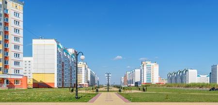 residential neighborhood: Panorama of a new residential neighborhood. Central alley with lanterns Stock Photo