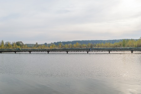 non urban scene: Long pedestrian bridge across the lake