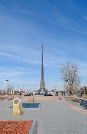konstantin: Moscow, Russia - March 29, 2016: Alley of Cosmonauts - memorial pedestrian street in the north of Moscow in front of the main entrance to The Exhibition of Achievements of National Economy (VDNH). At the end of the alley is a monument to Tsiolkovsky, foll