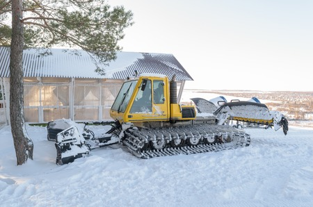 groomer: Orel, Russia - January 10, 2016: Snowcat Bombardier BR-275 Snow Groomer - groomers machine for preparation of ski runs and ski slopes - parked in the ski park Gorki